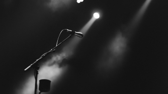 Dark Photo Of Microphone On Foggy Stage 4K 5K HD Wallpaper