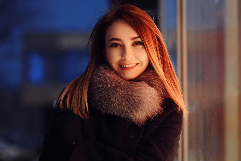 Red Long Hair Girl Winter Coat Smiling 4k Wallpaper