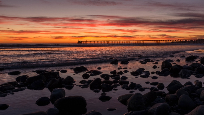 Sunset Bridge Sea Rocks Clouds 4K HD Wallpaper