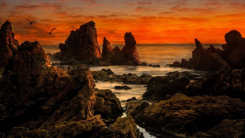Brown Rock Formation On Sea Under Sunset 4K HD Wallpaper