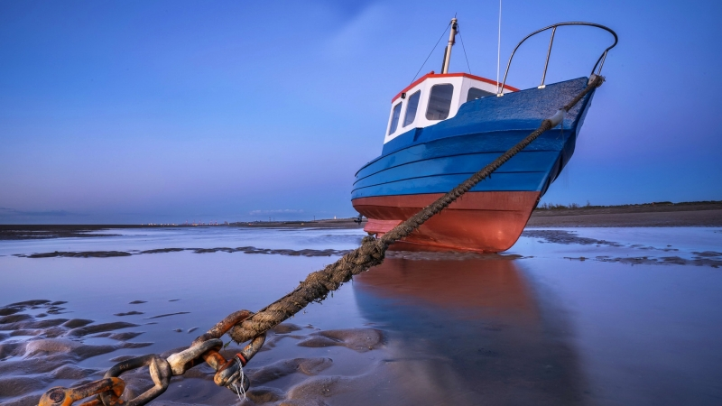 Blue Sky and Fishing Boat Trapped By An Anchor Caught On A Rope HD Nature Wallpaper