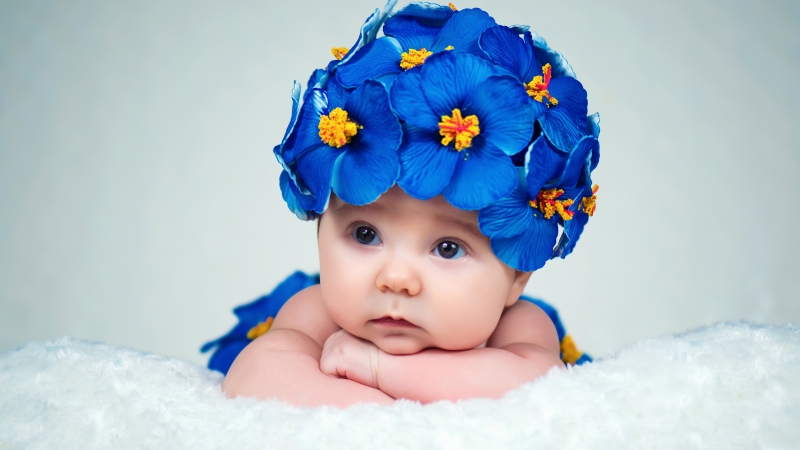 Cute Baby Lying Wearing Vilote Flowers In Head 4K 5K HD Cute Wallpaper