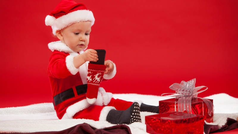 Cute Baby Wearing Christmas Dress In Front Of Gifts 4K 5K HD Cute Wallpaper