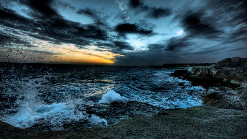 Dark Clouds Under Rough Sea With Brown Rocks During Sunset Time 4K 5K HD Nature Wallpaper